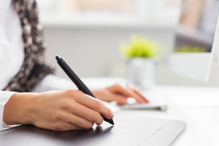 pen tablet: Designer using graphics tablet Stock Photo