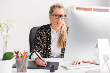 graphic illustration: Young professional female designer working with computer