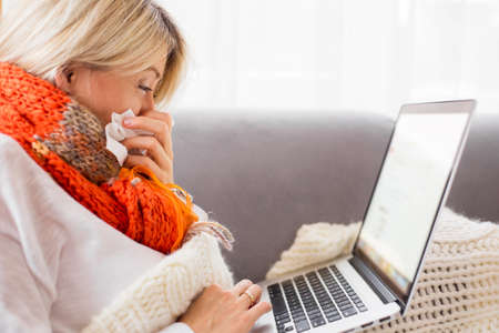 Sick woman working from home