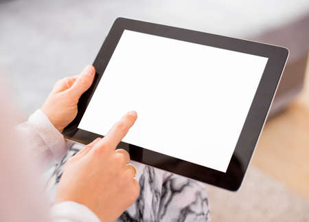 net book: Woman using tablet computer
