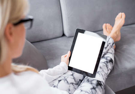Woman reading ebook on tablet computer