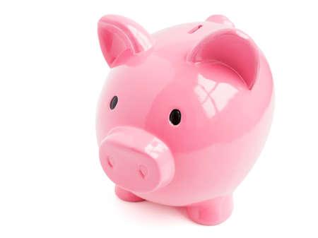 Pink piggy bank on white background photo