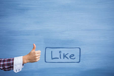 line up: Copyspace with Like button and hand showing thumb up gesture Stock Photo