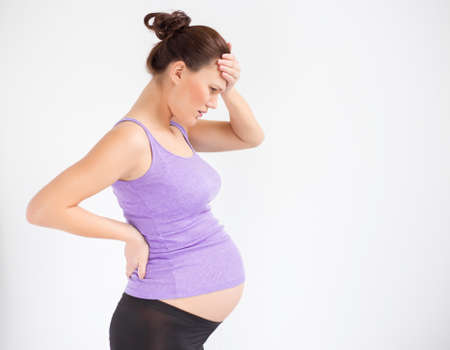 Pregnant woman having headache photo