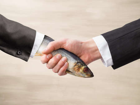 impression: Dead Fish Handshake