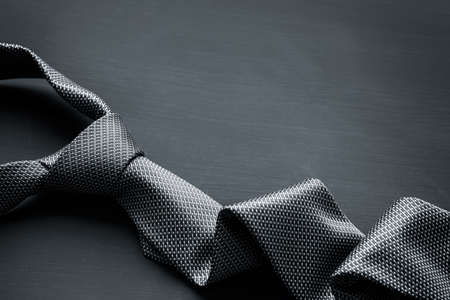 Grey tie on dark background Stock Photo