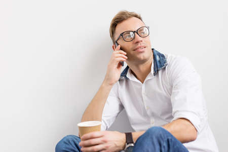 regular people: Young hipster talking on phone Stock Photo