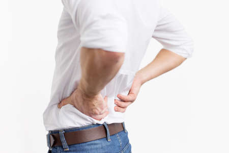 man back pain: Young man having back pain