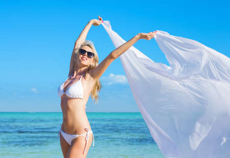bikini island: Happy woman in white bikini relaxing on the beach Stock Photo