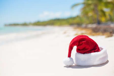 Red Christmas hat on the beach
