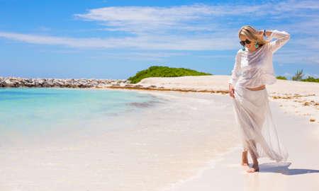 stylish women: Young happy woman walking on the beach