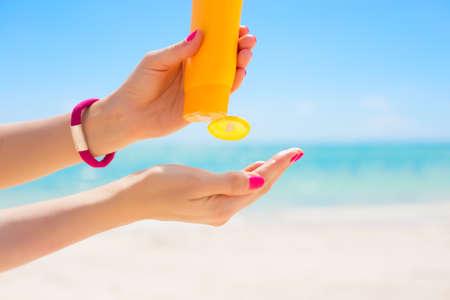 sunscreen: Woman using sunscreen Stock Photo