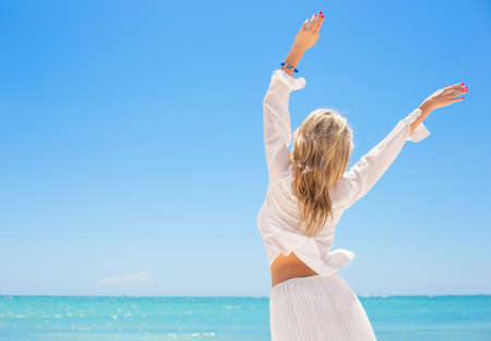 Happy woman enjoying hot summer day
