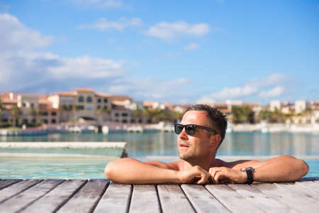 Young man relaxing in the swimming pool