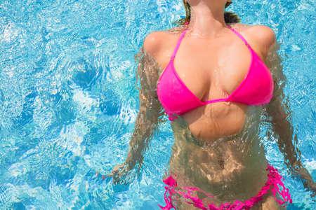 big boobs: Woman swimming in the pool