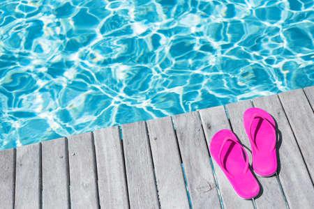flip flops: Pink flip flops by the swimming pool