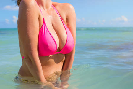 breast beauty: Woman in pink bikini