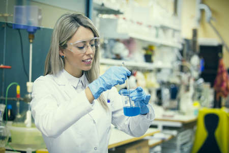 chemistry science: Female working in chemistry lab Stock Photo