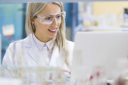 scientist woman: Portrait of chemist working in the lab Stock Photo