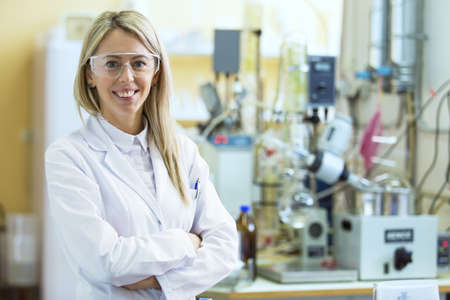 lab technician: Smiling young chemist in chemistry lab