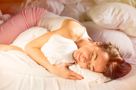sexy woman on bed: Happy woman in pajama sleeping in bed