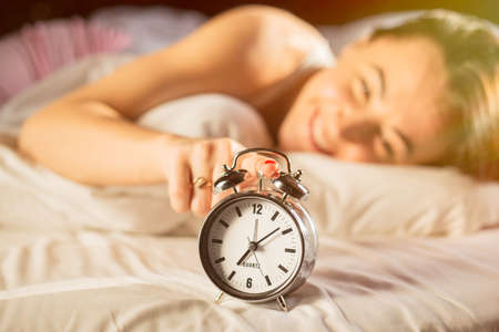 early morning: Happy woman waking up in morning Stock Photo