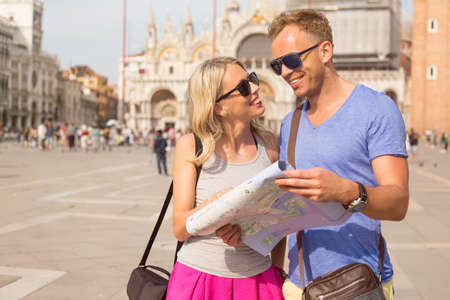 saint mark square: Young couple traveling in Venice Stock Photo