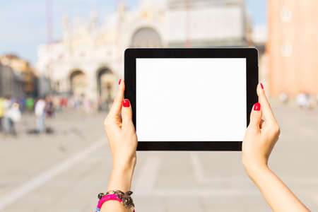 tablet computer: Tourist holding tablet computer with blank white screen Stock Photo