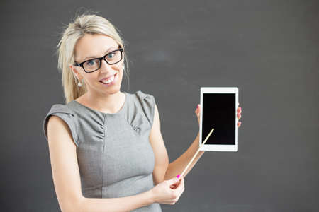 woman pointing: Teacher showing tablet computer