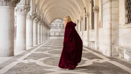 mysterious: Mysterious woman in red cloak