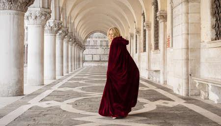 cloak: Mysterious woman in red cloak