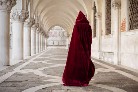 medieval: Mysterious woman in red cloak
