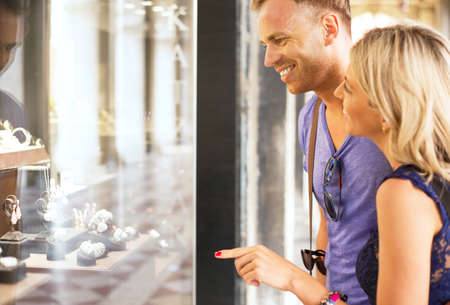 jewelry store: Couple looking at jewelry store window