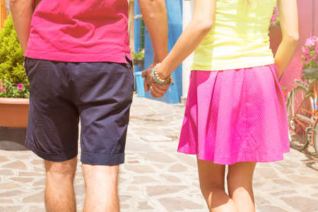 lovers holding hands: Romantic couple walking together and holding hands