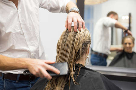 hair brush: Blonde woman in hair salon