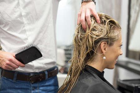 hair treatment: Blonde woman in hair salon