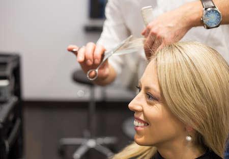 haircut: Young woman getting new haircut
