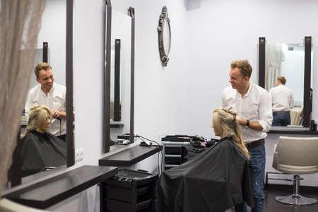 Hairdresser working in hair salon Stock Photo