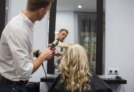 Hairdresser working in hair salon Stock Photo