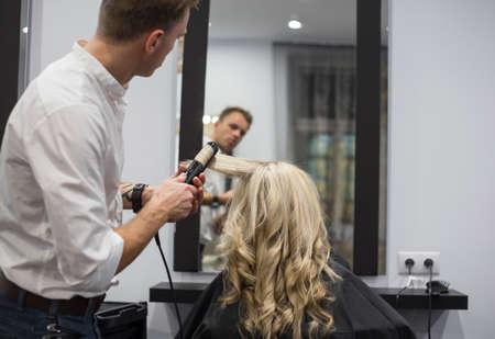 hair salon: Hairdresser working in hair salon Stock Photo