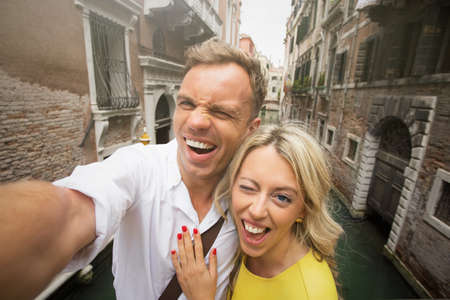 love pic: Cheerful couple taking funny selfie picture Stock Photo