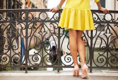 Romantic lady standing on the bridge