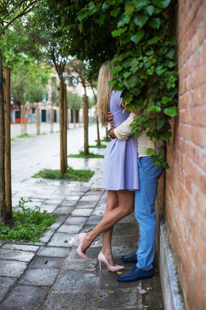 lover: Couple kissing on the street Stock Photo