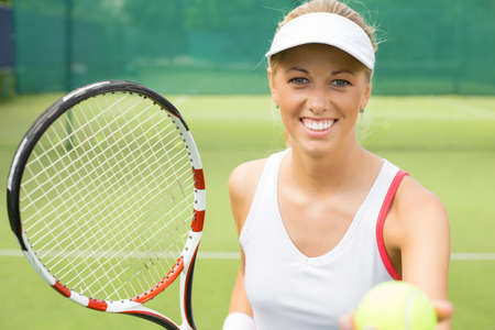 tennis player: Young cheerful tennis player in the training Stock Photo