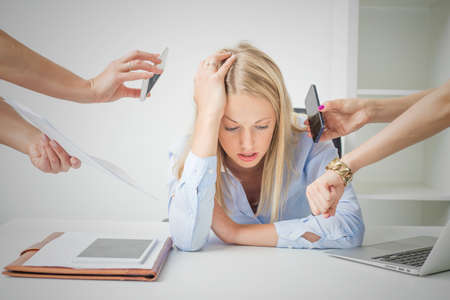 Woman overloaded with stuff at work Standard-Bild