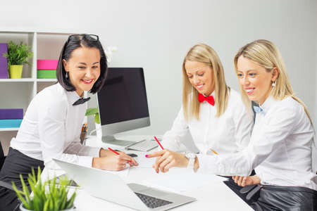 women business: Three business women meeting in the office Stock Photo