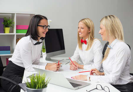 young women: Young creative business women in the office