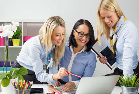 business marketing: Creative women working together in the office