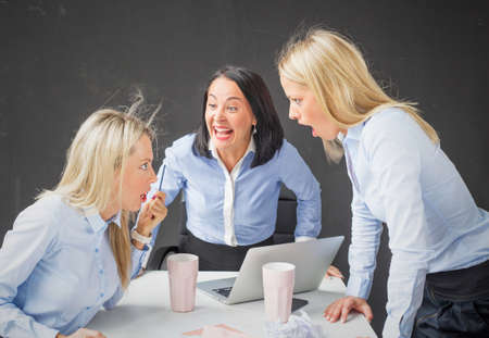 difficult lives: Women colleagues arguing and screaming in the office
