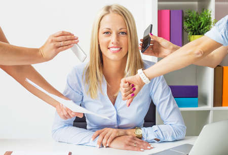 good attitude: Stress free business woman in the office Stock Photo